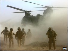 British troops near a helicopter in Afghanistan