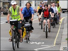 A convoy of less experienced cyclists follow an instructor in King Street, Hammersmith, west London