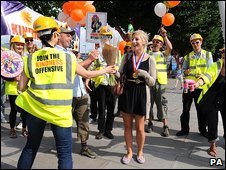 """Katie Moore, 23, (centre) enjoys an impromptu """"party"""" thrown for her by The Kindness Offensive"""