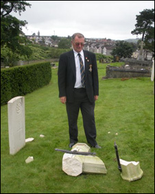 Alan Woodcock surveys the damage to the memorial at Llantwit, Neath