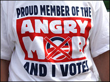"An opponent of healthcare reform at a Hagerstown, Maryland, town hall meeting wears a T-shirt that reads: ""Proud member of the angry mob - and I vote""."