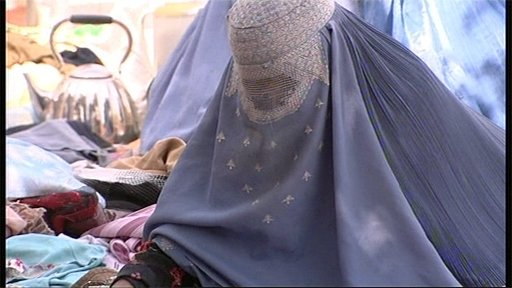 Afghan woman in market