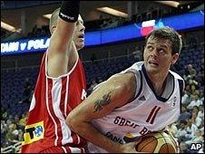 "Joel Freeland scores past Poland""s Maciej Lampe"
