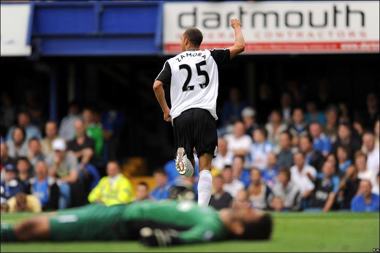 Fulham's Bobby Zamora wheels away from David James