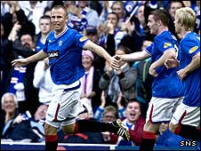 Rangers striker Kenny Miller celebrates his goal