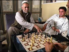 Naimatullah Zalmay playing chess