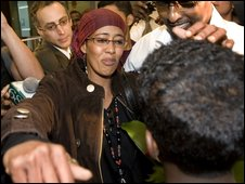 Suaad Mohamud reaches for her 12-year-old son on arrival in Toronto