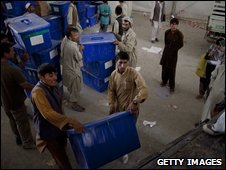 Election material is loaded onto trucks en route to polling stations in Kabul on 16 August 2009