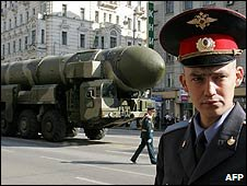 A policeman stands near a missile-launcher in Moscow on 5 May during a rehearsal for the Victory Day parade, May 2008