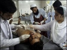 Hospital staff treat an injured victim of the blast