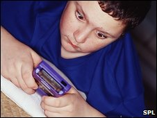 Obese  child with handheld
