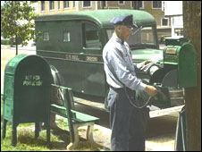 Postman collecting mail c.1950