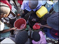 Children waiting to fill buckets with water (Image: AP)