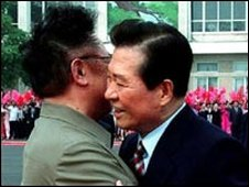 Kim Dae Jung greets Kim Jong Il