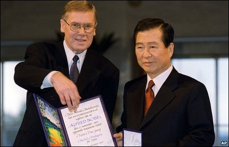 South Korea's President Kim Dae-jung, right, and Gunnar Berge, chairman of the Norwegian Nobel Committee, show the diploma and the medal after Kim was awarded the Nobel Peace Prize, 2000.