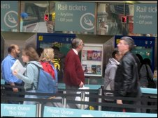 Train travellers queue for tickets