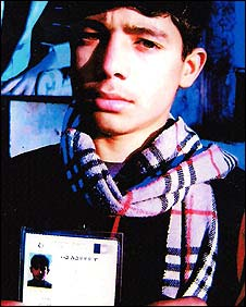 Afghan voter with a registration card