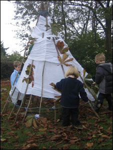 Farley Nursery children build a wigwam