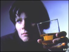 A woman and a glass of whisky
