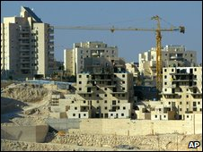A crane works to construct the hilltop Israeli settlement of Maaleh Adumim, the West Bank's largest settlement