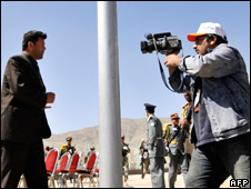 Afghan journalists report on a militant attack in Kabul on 27 April 2008