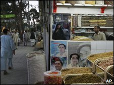 Photos of presidential candidate Abdullah Abdullah in a Kabul shop selling dried fruits