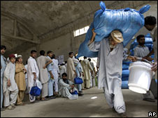A man receives UN food aid in northern Pakistan on 8 July 2009