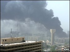 Plumes of smoke fill the sky after car bombs shook Baghdad on Wednesday