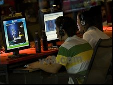 Young Chinese men play computer games at an internet cafe in Beijing - 6 August 2009