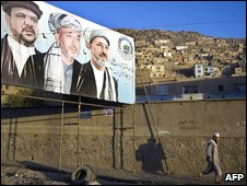 Poster of president Hamid Karzai (C) and running mates Mohamad Qasim Fahim (L) and Karim Khalili (R) in Kabul