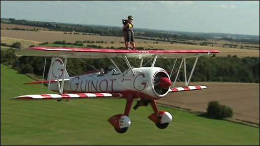 Tiger Brewer takes to the skies on his grandfather's bi-plane