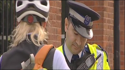 Met police officer with a cyclist