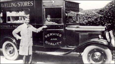 black and white image showing the van and two men - one driving and the other standing outside