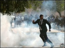 A Pakistani lawyer throws a rock at police on 5 November 2007