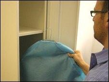 A man leaving a suit in a LaundryRepublic locker