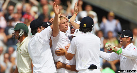 Teammates lay hands on Flintoff