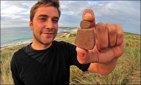 Archaeologist for Historic Scotland Jakob Kainz with the discovery of the face [Pic: Historic Scotland]