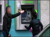 Gypsy child at a cashpoint in Madrid, Spain