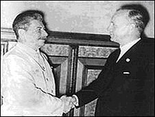 Joseph Stalin shakes hands with Joachim von Ribbentrop