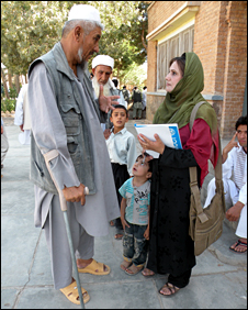 Reshtin Qadri of Radio Free Europe talks to a voter in Herat