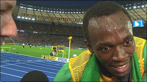 Usain Bolt looking hot, sweaty and out of breath.