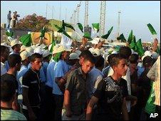 Libyans gather in Tripoli ahead of the arrival of Abdelbaset Ali al-Megrahi, 20 August 2009
