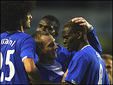 Louis Saha (right) is congratulated by his team-mates