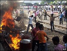 People destroying railway property in Bihar