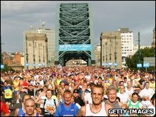 Runners in Great North Run by Tyne Bridge