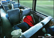 Woman sleeps on the bus