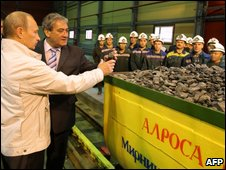 Prime Minister Vladimir Putin examines chunks of uncut diamonds at a diamond mine in the Siberian city of Mirny