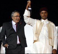 Abdelbaset Ali al-Megrahi (left) joins hands with Seif al-Islam Gaddafi in Tripoli, 20 August