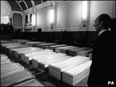 Coffins of bomb victims in Lockerbie&quot;s town hall, 27 December 1988   