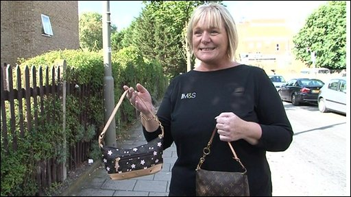Woman trys to 'spot' the fake from the real designer handbag